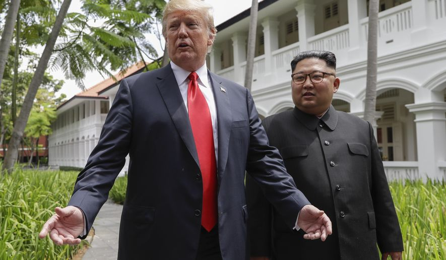 In this June 12, 2018, file photo, U.S. President Donald Trump and North Korea leader Kim Jong Un stop to talk with the media as they walk from their lunch at the Capella resort on Sentosa Island in Singapore. Trump and Kim are planning a second summit in the Vietnam capital of Hanoi, Feb. 27-28. (AP Photo/Evan Vucci, File)