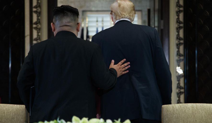 In this June 12, 2018, file photo, President Donald Trump and North Korean leader Kim Jong Un walk off after a signing ceremony during a meeting on Sentosa Island in Singapore. Trump and Kim are planning a second summit in the Vietnam capital of Hanoi, Feb. 27-28. (AP Photo/Evan Vucci, File)