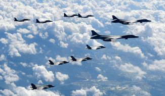 FILE - In this Sept. 18, 2017, file photo provided by South Korea Defense Ministry, U.S. Air Force B-1B bombers, F-35B stealth fighter jets and South Korean F-15K fighter jets fly over the Korean Peninsula during joint drills. Ahead of the second summit between U.S. President Donald Trump and North Korean leader Kim Jong Un, some observers say there is an uncertainty over the future of the decades-long military alliance between Washington and Seoul. (South Korea Defense Ministry via AP, File)