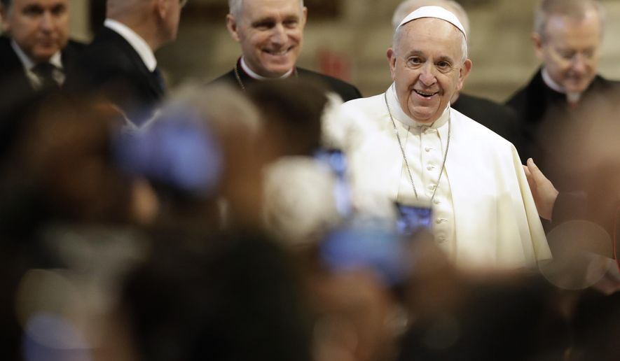 Pope Francis arrives in St. Peter's Basilica at the Vatican for a audience with pilgrims coming from the diocese of Benevento, Wednesday, Feb. 20, 2019. (AP Photo/Alessandra Tarantino)