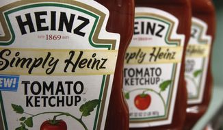 This March 2, 2011, file photo, shows containers of Heinz ketchup on the shelf of a market, in Barre, Vt. Shares in Kraft Heinz are expected to plunge when markets open Friday, Feb. 22, 2019, after the consumer goods company said it was being investigated by U.S. regulators and it reported a massive loss. (AP Photo/Toby Talbot, File)