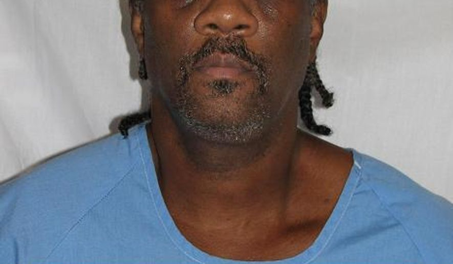 FILE - This undated file photo provided by the California Department of Corrections and Rehabilitation shows inmate Kevin Cooper. California Gov. Gavin Newsom has ordered DNA testing on all evidence that Cooper says would prove his innocence in his 35-year-old murder case that has drawn national attention. Newsom on Friday, Feb. 22, 2019, ordered testing of hair, blood, fingernail scrapings from the victims and a green button. Cooper says the testing will show he was framed for the 1983 killings of four people in Chino Hills. (California Department of Corrections and Rehabilitation via AP, File)