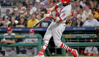 FILE - In this Aug. 3, 2018, file photo, St. Louis Cardinals' Dexter Fowler hits a single off Pittsburgh Pirates starting pitcher Chris Archer to drive in Tyler O'Neill during the fifth inning of a baseball game in Pittsburgh. Fowler is entering the third season of a five-year, $82 million contract. An All-Star with Chicago in 2016 when he posted a .393 on-base percentage to help lead the Cubs to their first World Series title in more than a century, Fowler scored 186 runs during a two-year stint with Chicago prior to joining St. Louis. (AP Photo/Keith Srakocic, File)