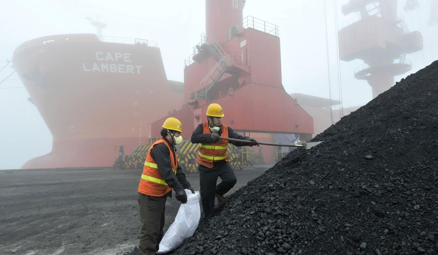 In this Feb. 24, 2010, photo, inspection and quarantine workers take samples of imported coal at a port in Rizhao in eastern China's Shandong province. Australia's Trade Minister Simon Birmingham said Friday, Feb. 22, 2019, that while there might be some delays in the processing of coal shipments at Chinese ports, he has no reason to believe China is banning Australian coal. (Chinatopix via AP)
