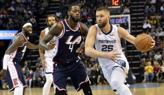 Memphis Grizzlies forward Chandler Parsons (25) handles the ball against Los Angeles Clippers forward JaMychal Green (4) in the second half of an NBA basketball game Friday, Feb. 22, 2019, in Memphis, Tenn. (AP Photo/Brandon Dill)  **FILE**