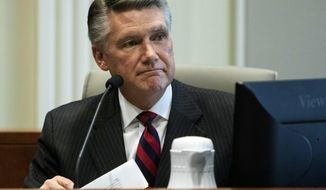 Mark Harris, Republican candidate in North Carolina's 9th congressional race, makes a statement before the state board of elections calling for a new election during the fourth day of a public evidentiary hearing on the 9th congressional district voting irregularities investigation Thursday, Feb. 21, 2019, at the North Carolina State Bar in Raleigh, N.C. (Travis Long/The News & Observer via AP, Pool)