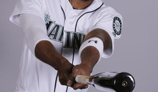 FILE - This is a Feb. 18, 2019, file photo showing Dee Gordon of the Seattle Mariners baseball team. Gordon is healthy again and back at his normal position. He expects to be back up to speed in his second season with the Mariners. (AP Photo/Charlie Riedel, File)