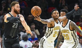 Atlanta Hawks guard Kent Bazemore (24) gets his hand on a pass by Detroit Pistons forward Blake Griffin (23) for a steal during the first half of an NBA basketball game, Friday, Feb. 22, 2019, in Atlanta. (AP Photo/John Amis)