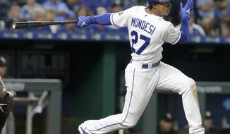 FILE - In this Sept. 12, 2018, file photo, Kansas City Royals' Adalberto Mondesi hits an RBI-single during the fifth inning of a baseball game against the Chicago White Sox in Kansas City, Mo. The Royals have been waiting patiently for Mondesi to develop into the player they thought he could be. The time could be now. (AP Photo/Charlie Riedel, File)