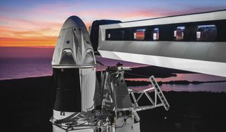 This undated photo made available by SpaceX on Feb 6, 2019 shows the Dragon crew capsule atop a Falcon 9 rocket at the launch pad at Kennedy Space Center in Florida where the Saturn Vs and space shuttles were launched. On Friday, Feb. 22, 2019, NASA and SpaceX announced the approval of an unmanned test flight for the new commercial capsule. (SpaceX via AP)