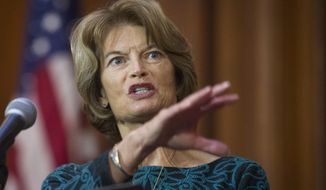 FILE - In this Tuesday, Dec. 11, 2018 file photo, Sen. Lisa Murkowski, R-Alaska, speaks after an order withdrawing federal protections for countless waterways and wetland was signed, at EPA headquarters in Washington. U.S. Sen. Lisa Murkowski says she is likely to support a resolution of disapproval over President Donald Trump's declaration of a national emergency to secure more money for a wall on the U.S.-Mexico border, Friday, Feb. 22, 2019. (AP Photo/Cliff Owen, File)