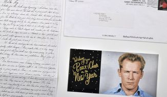 """This photo provided by Urban Culture Auctions in West Palm Beach, Fla., shows a hand-written letter by the late mobster James """"Whitey"""" Bulger, an envelope and a holiday greeting card emblazoned with his 1959 Alcatraz mugshot, that Bulger mailed from federal prison in Coleman, Fla., in 2015. The items are among those being offered by the auction house for auction on Sunday, Feb. 24, 2019. Bulger was found dead in a wheelchair on Oct. 30, 2018, killed by inmates within hours of his transfer to a prison in Hazelton, W.V. He was 89. (Darin Rone/Urban Culture Auctions via AP)"""