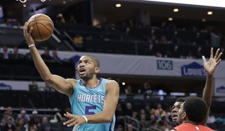Charlotte Hornets forward Nicolas Batum (5) drives past Washington Wizards guard Bradley Beal (3) and Washington Wizards guard Tomas Satoransky (31) during the first half of an NBA basketball game in Charlotte, N.C., Friday, Feb. 22, 2019. (AP Photo/Chuck Burton)
