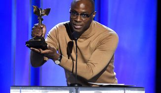 "Barry Jenkins accepts the award for best director for ""If Beale Street Could Talk"" at the 34th Film Independent Spirit Awards on Saturday, Feb. 23, 2019, in Santa Monica, Calif. (Photo by Chris Pizzello/Invision/AP)"