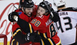 Calgary Flames' Andrew Mangiapane, right, celebrates his goal against the Anaheim Ducks with teammate Garnet Hathaway during the third period of an NHL hockey game Friday, Feb. 22, 2019, in Calgary, Alberta. (Jeff McIntosh/The Canadian Press via AP)