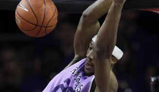 Kansas State forward Xavier Sneed dunks during the first half of an NCAA college basketball game against Oklahoma State in Manhattan, Kan., Saturday, Feb. 23, 2019. (AP Photo/Orlin Wagner)