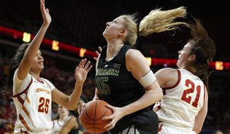 Baylor forward Lauren Cox, center, drives to the basket between Iowa State's Kristin Scott, left, and Bridget Carleton, right, during the first half of an NCAA college basketball game, Saturday, Feb. 23, 2019, in Ames, Iowa. (AP Photo/Charlie Neibergall)