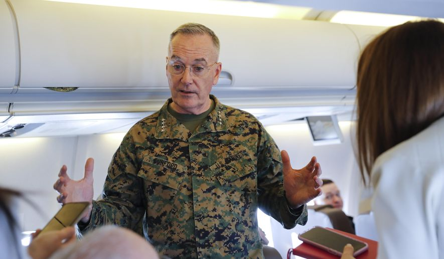 Joint Chiefs Chairman Gen. Joseph Dunford gestures while speaking to reporters during a briefing on a military aircraft before arrival at El Paso International airport, Saturday, Feb. 23, 2019. Dunford is traveling with Acting Secretary of Defense Patrick Shanahan and they are planning to pay a visit to Texas-Mexico border. (AP Photo/Pablo Martinez Monsivais, Pool)
