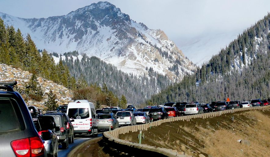 In this Jan. 7, 2018, photo, traffic backs up on Interstate 70 near Silverthorne, Colo., a familiar scene on the main highway connecting Denver to the mountains. Heavy ski traffic along the interstate has been common for years, but Colorado's recent population boom is making it increasingly challenging for transportation officials who deal with a bare-bones budget. (AP Photo/Thomas Peipert) **FILE**