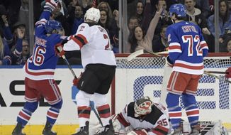 New York Rangers center Ryan Strome (16) celebrates his goal against New Jersey Devils goaltender Cory Schneider (35) as Devils defenseman Eric Gryba (2) and Rangers center Filip Chytil (72) look on during the first period of an NHL hockey game Saturday, Feb. 22, 2019, at Madison Square Garden in New York. (AP Photo/ Bill Kostroun)