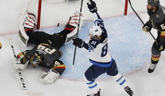 Winnipeg Jets left wing Kyle Connor (81) celebrates after Winnipeg Jets right wing Patrik Laine scored against Vegas Golden Knights goaltender Marc-Andre Fleury (29) during the second period of an NHL hockey game Friday, Feb. 22, 2019, in Las Vegas. (AP Photo/John Locher)
