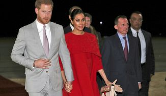 Britain's Prince Harry and Meghan Duchess of Sussex, arrive at the Casablanca Airport in Casablanca, Morocco, Saturday Feb. 23, 2019.  The royal couple, who are expecting their first child in the Spring, will be in Morocco for a three day visit. (Hannah McKay/Pool via AP)