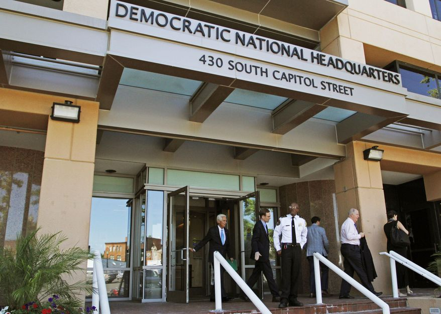 In this June 14, 2016, file photo, people stand outside the Democratic National Committee headquarters in Washington. Hackers tried to break into DNC inboxes in March 2016 and intensified their efforts in early April. (AP Photo/Paul Holston, File)