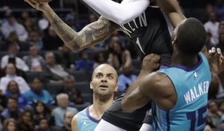 Brooklyn Nets' D'Angelo Russell (1) drives against Charlotte Hornets' Kemba Walker (15) during the first half of an NBA basketball game in Charlotte, N.C., Saturday, Feb. 23, 2019. (AP Photo/Chuck Burton)