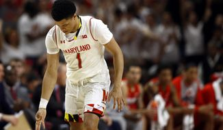 Maryland guard Anthony Cowan Jr. gestures after making a 3-pointer in the first half of an NCAA college basketball game against Ohio State, Saturday, Feb. 23, 2019, in College Park, Md. (AP Photo/Patrick Semansky)