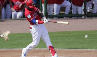 Philadelphia Phillies' Andrew McCutchen bats during the first inning of a spring training baseball game against the Pittsburgh Pirates, Saturday, Feb. 23, 2019, in Clearwater, Fla. McCutchen was safe at first on a throwing error by Pittsburgh Pirates third baseman Colin Moran. (AP Photo/Lynne Sladky)