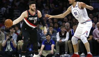 Portland Trail Blazers center Jusuf Nurkic (27) moves the ball around Philadelphia 76ers center Boban Marjanovic (51) during the first half on an NBA basketball game, Saturday, Feb. 23, 2019, in Philadelphia. (AP Photo/Laurence Kesterson)