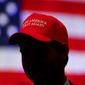 The MAGA hat worn by President Trump's supporters has triggered angry confrontations and political violence across the U.S. with alarming frequency. (Associated Press) ** FILE **