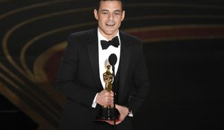"""Rami Malek accepts the award for best performance by an actor in a leading role for """"Bohemian Rhapsody"""" at the Oscars on Sunday, Feb. 24, 2019, at the Dolby Theatre in Los Angeles. (Photo by Chris Pizzello/Invision/AP)"""
