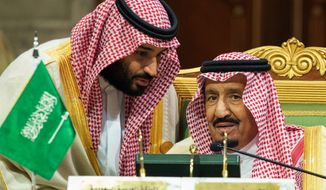 In this Dec. 9, 2018, file photo, released by the state-run Saudi Press Agency, Saudi Crown Prince Mohammed bin Salman, left, speaks to his father, King Salman, at a meeting of the Gulf Cooperation Council in Riyadh, Saudi Arabia. (Saudi Press Agency via AP)