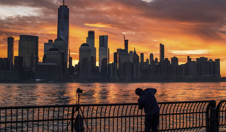A photographer captures the sunrise behind the New York City skyline from across the Hudson River in Jersey City, N.J., Tuesday, Feb. 5, 2019. (AP Photo/J. David Ake) ** FILE **