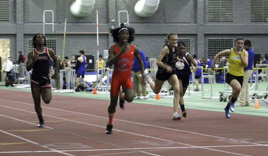 In this Thursday, Feb. 7, 2019 photo, Bloomfield High School transgender athlete Terry Miller, second from left, wins the final of the 55-meter dash over transgender athlete Andraya Yearwood, left, and other runners in the Connecticut girls Class S indoor track meet at Hillhouse High School in New Haven, Conn. In the track-and-field community in Connecticut, the dominance of Miller and Yearwood has stirred resentment among some competitors and their families. (AP Photo/Pat Eaton-Robb)