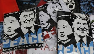 T-shirts with portraits of President Trump and North Korean leader Kim Jong-un are displayed in a tourist area in Hanoi, Vietnam. The two leaders will hold their second summit this week. (Associated Press)
