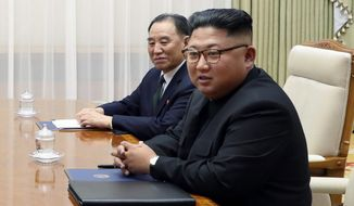 North Korean leader Kim Jong-un (right) will be meeting with President Trump this week for denuclearization talks, but it's Kim Yong-chol (background) who has prevented concrete action since their first summit in Singapore in June. (Associated Press)
