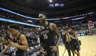 Georgetown center Jessie Govan (15) and guard Jahvon Blair (0) leave the court after an NCAA college basketball game against Villanova, Wednesday, Feb. 20, 2019, in Washington. Georgetown won 85-73. (AP Photo/Nick Wass) **FILE**