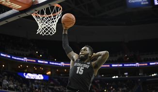 Georgetown center Jessie Govan (15) goes to the basket during the second half of an NCAA college basketball game against Villanova, Wednesday, Feb. 20, 2019, in Washington. Georgetown won 85-73. (AP Photo/Nick Wass) **FILE**