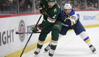 Minnesota Wild defenseman Anthony Bitetto controls the puck against St. Louis Blues defenseman Vince Dunn (29) in the first period of a NHL hockey game Sunday, Feb. 24, 2019, in St. Paul, Minn. (AP Photo/Andy Clayton-King)
