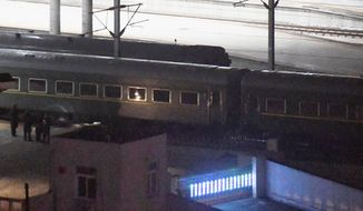 In this Saturday, Feb. 23, 2019, photo, a train similar to ones seen during previous visits to China by North Korean leader Kim Jong Un leaves Dandong Station in northeastern China's Liaoning Province. Kim was on a train Sunday, Feb. 24, 2019, to Vietnam for his second summit with U.S. President Donald Trump, state media confirmed. (Madoka Ikegami/Kyodo News via AP)