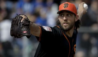 San Francisco Giants starting pitcher Madison Bumgarner throws against the Chicago Cubs during the first inning of a spring baseball game in Scottsdale, Ariz., Sunday, Feb. 24, 2019. (AP Photo/Chris Carlson)