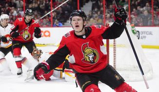 Ottawa Senators left wing Brady Tkachuk (7) celebrates a goal against the Calgary Flames during the second period of an NHL hockey game, Sunday, Feb. 24, 2019 in Ottawa, Ontario. (Sean Kilpatrick/The Canadian Press via AP)