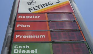 FILE- This June 14, 2018, file photo shows signage and gas prices for regular and diesel at Flying J along Interstate 85 and 40 near Graham, N.C. The average U.S. price of regular-grade gasoline is up a dime a gallon (3.8 liters) over the past two weeks. (AP Photo/Gerry Broome, File)
