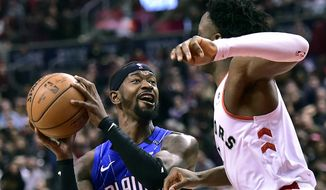 Orlando Magic guard Terrence Ross (31) looks to keep the ball away from Toronto Raptors forward OG Anunoby (3) as he looks for the shot  during the second half NBA basketball game, Sunday, Feb. 24, 2019 in Toronto (Frank Gunn/The Canadian Press via AP)
