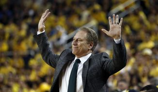 Michigan State head coach Tom Izzo reacts during the first half of an NCAA college basketball game against Michigan, Sunday, Feb. 24, 2019, in Ann Arbor, Mich. (AP Photo/Carlos Osorio)