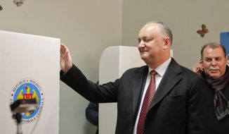 Moldova's President Igor Dodon smiles after casting his vote in the country's parliamentary elections in Chisinau, Moldova, Sunday, Feb. 24, 2019. Moldovans voted Sunday in a parliamentary election that could deepen the split between pro-Western and pro-Russian forces in the former Soviet republic. (AP Photo/Vadim Ghirda) **FILE**