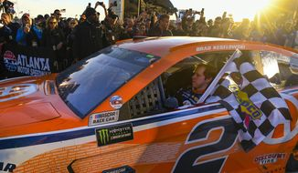 Brad Keselowski drives into Victory Lane after winning a Monster Energy NASCAR Cup Series auto race at Atlanta Motor Speedway, Sunday, Feb. 24, 2019, in Hampton, Ga. (AP Photo/John Amis)