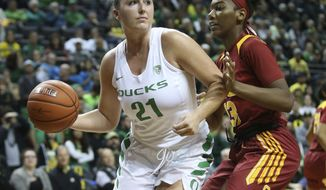 Oregon's Erin Boley, left, passes the ball under pressure from Southern California's Asiah Jones during the fourth quarter of an NCAA college basketball game Sunday, Feb. 24, 2019, in Eugene, Ore. (AP Photo/Chris Pietsch)